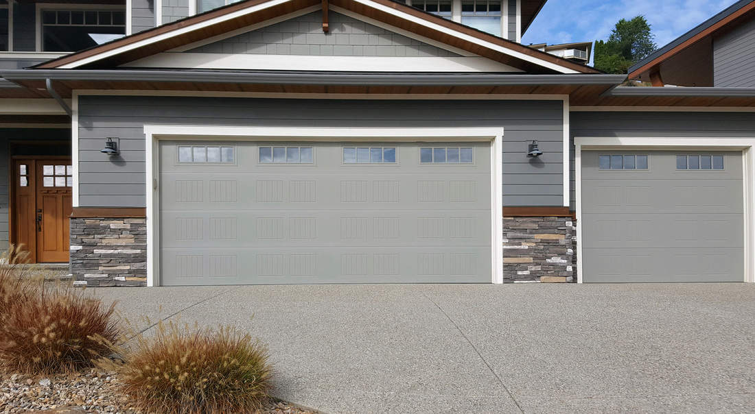 Front exterior view close- up of 3 car garage. One two car garage and one single car garage.