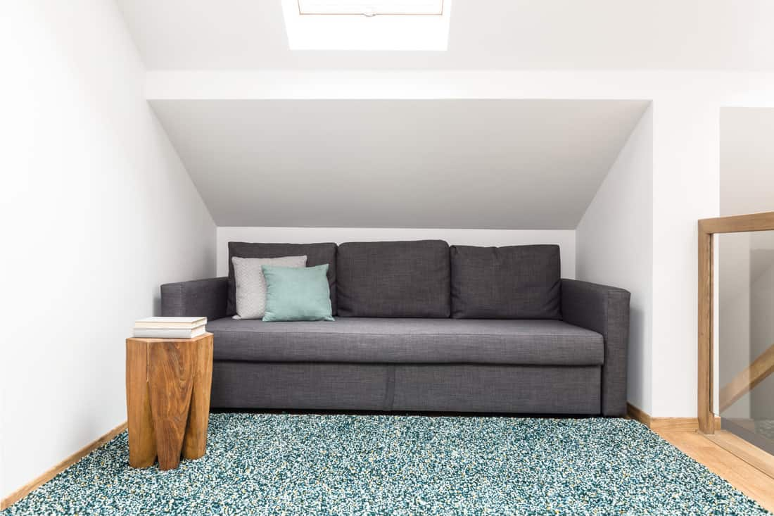Gray sofa in white attic interior. Charcoal Grey Sofa And A Light Turquoise Area Rug