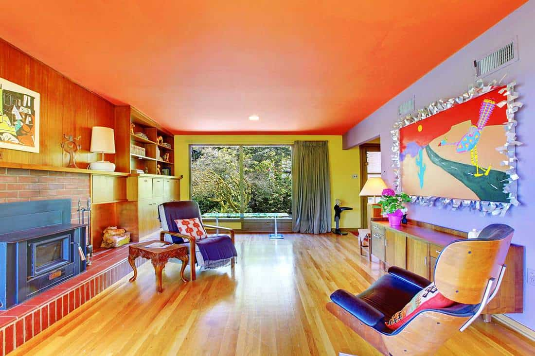 Home living room interior with parquet floor and orange ceiling