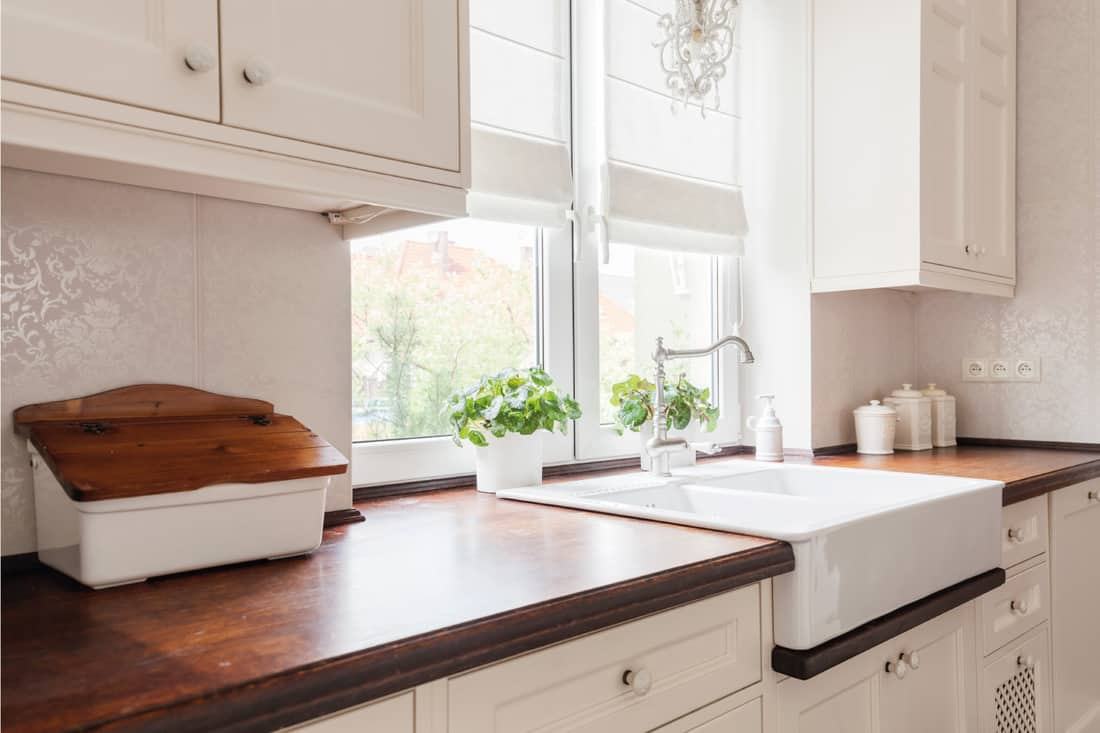 Horizontal view of designed retro kitchen with white porcelain cabinet knobs