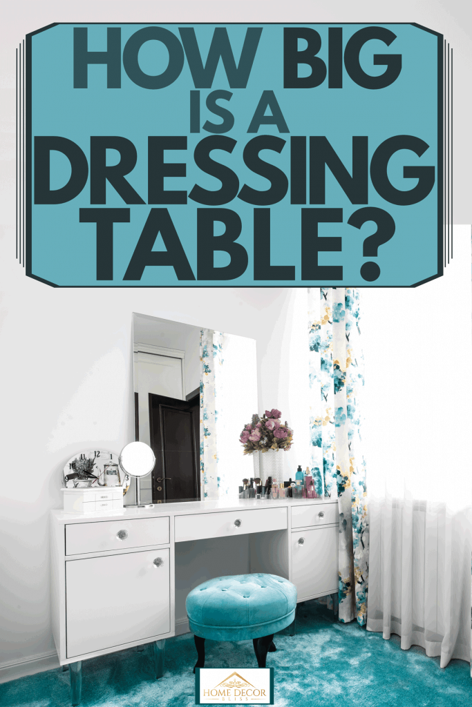 A blue themed dressing room with floral curtains, blue carpet, a small blue round chair, and a white dressing table, How Big Is A Dressing Table?