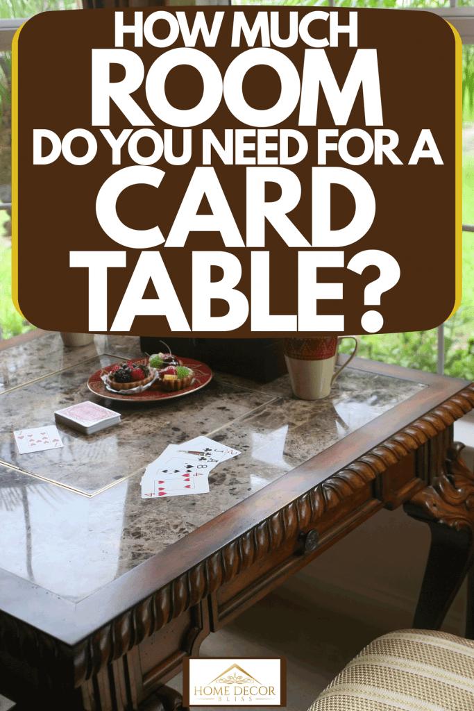 A-dark-wooden-vintage-design-card-table-near-the-window