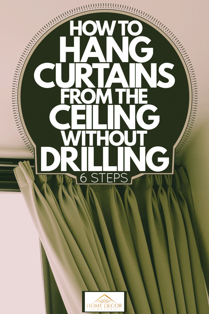 A green curtain hanged on the ceiling of a house, How To Hang Curtains From The Ceiling Without Drilling [6 Steps]