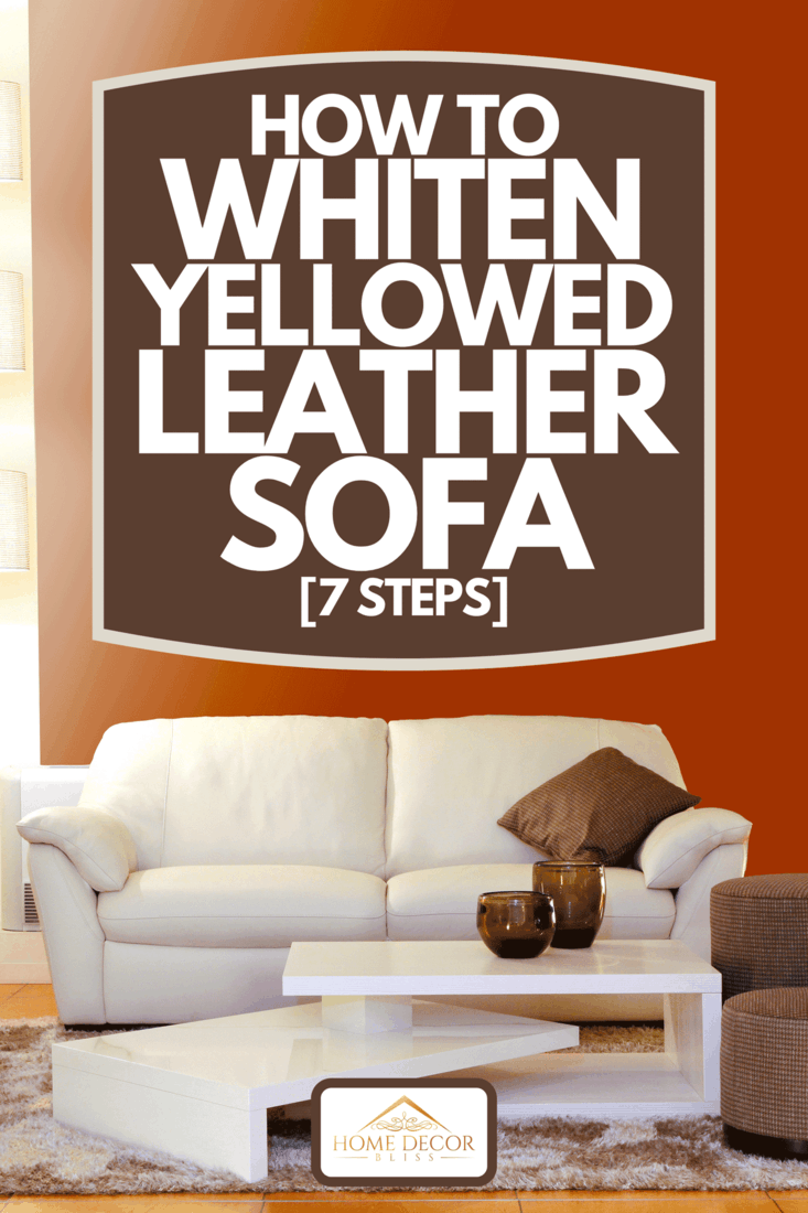 A living room with white sofa, brown pouf and white coffee table, How To Whiten Yellowed Leather Sofa [7 Steps]