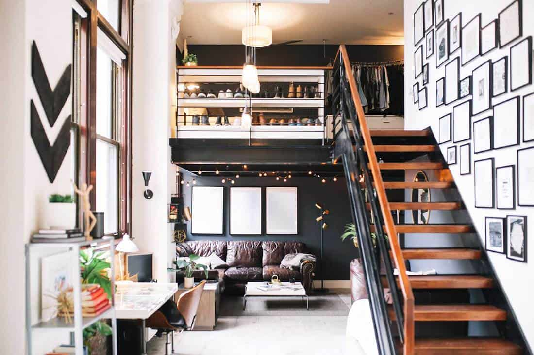 Interior of a large and bright loft apartment with framed photos on wall