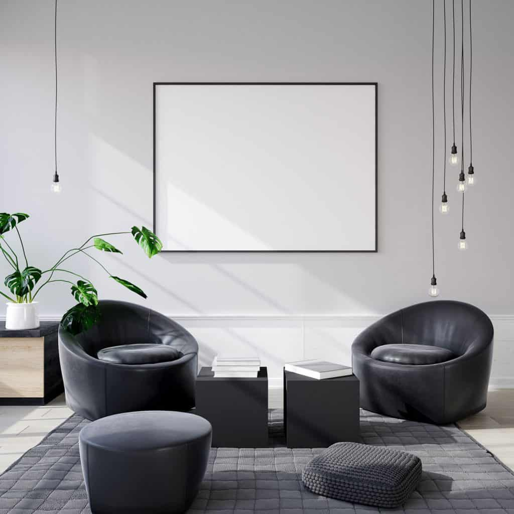 Interior of a modern living room with a small reading nook area, gray patterned fabric carpet, and a white mockup picture frame