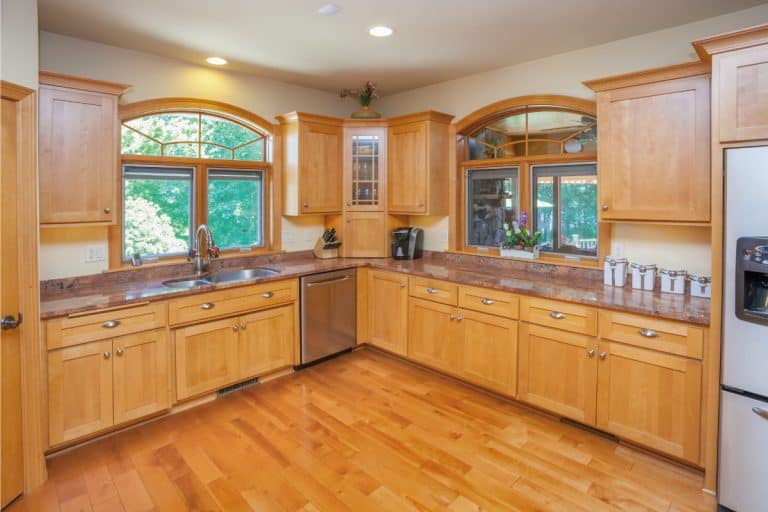 Kitchen With Hardwood Floor, Cabinetry, and Marble Counters. What Color Quartz Countertops Go With Maple Cabinets