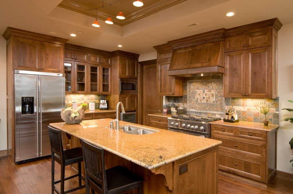 Kitchen with granite island and walnut cabinets