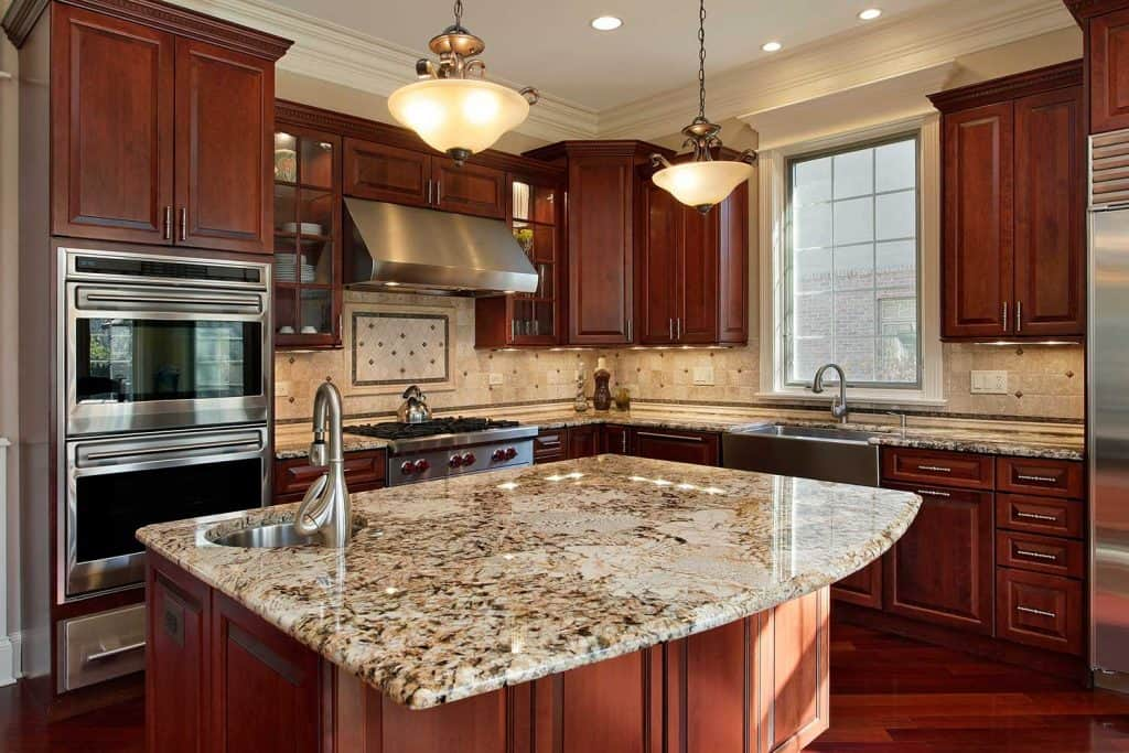 Kitchen with granite island and wooden cabinets
