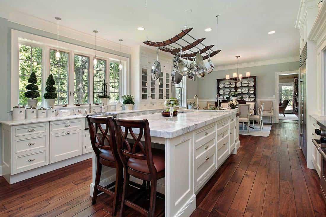 Kitchen with white granite island and hardwood floor