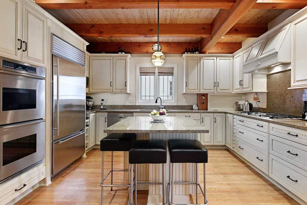 Kitchen with wood ceiling beams