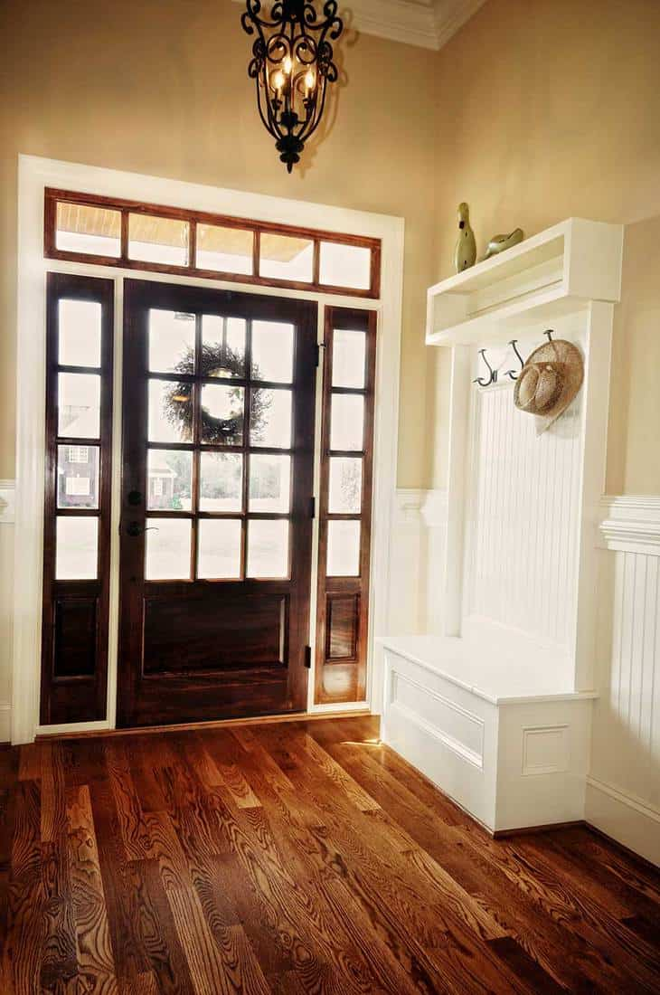 Large foyer with nice wood detail