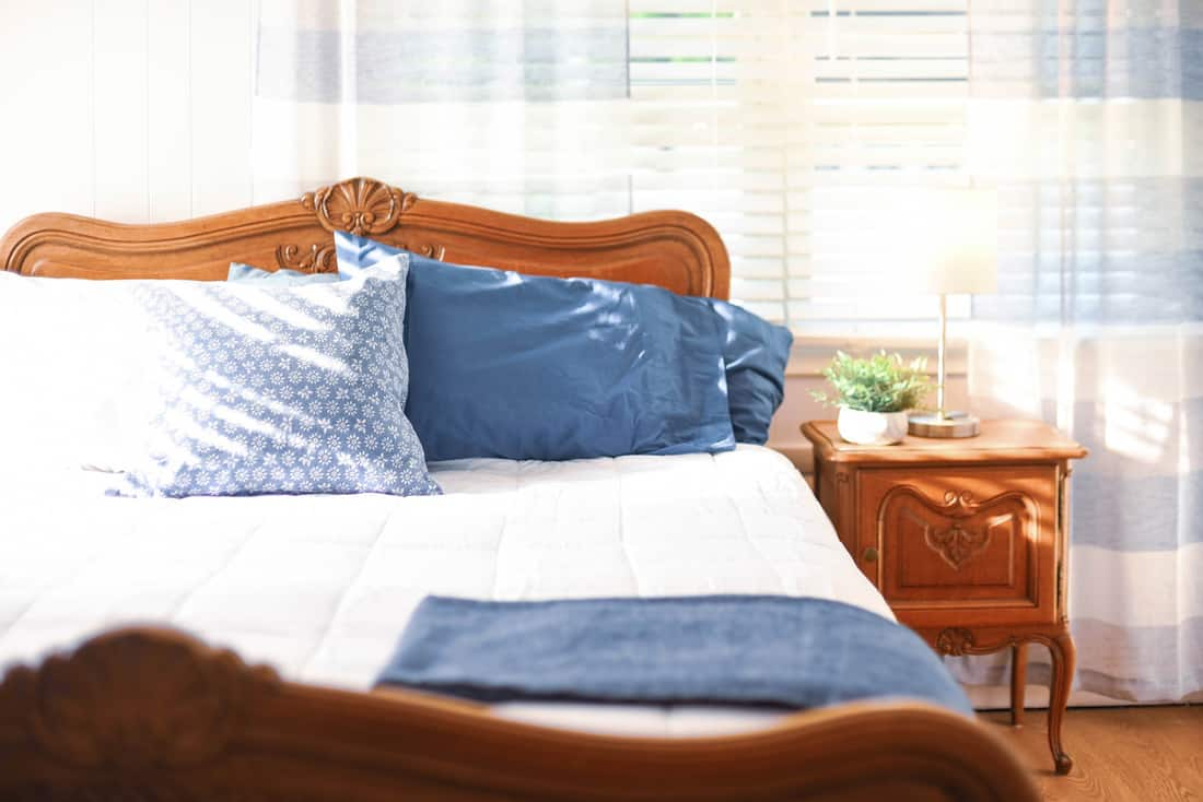 Light and bright bedroom decor in gray, white and blue palette