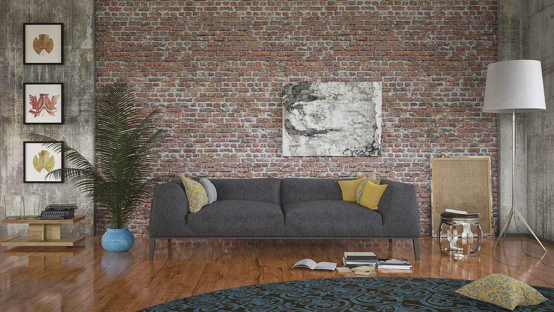 Living room interior with gray sofa, canvas artwork on brick wall and standing lamp