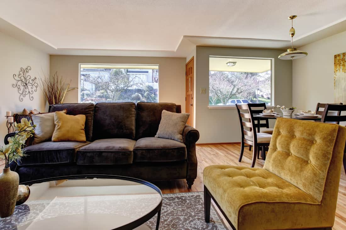 Living room with brown sofa and mustard yellow chair