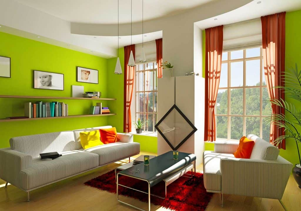 Living room with green wall sofa and table on red carpet rug
