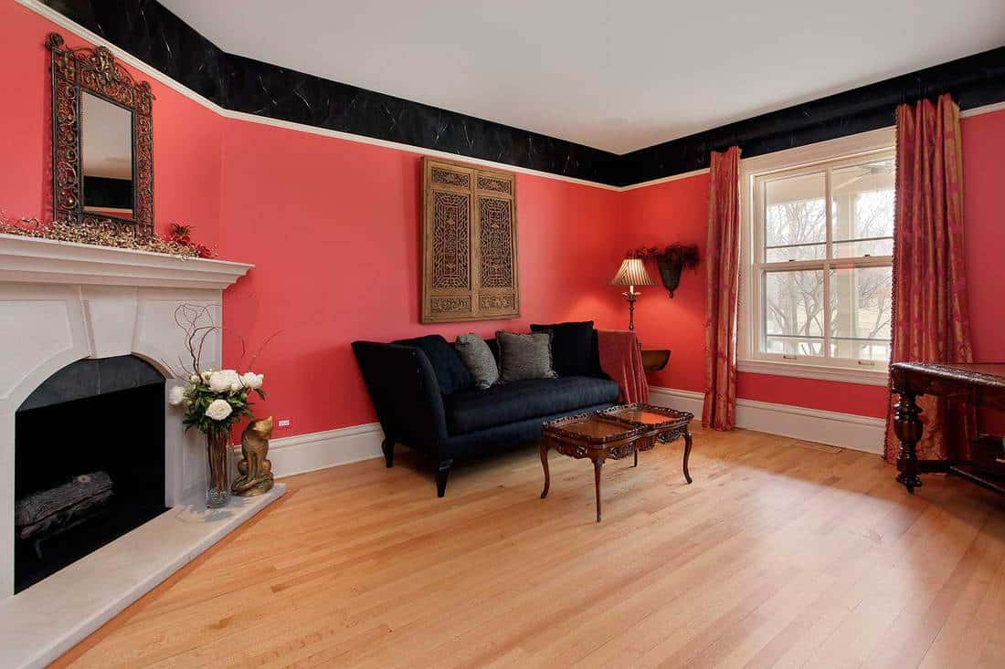 Living room with red walls and fireplace
