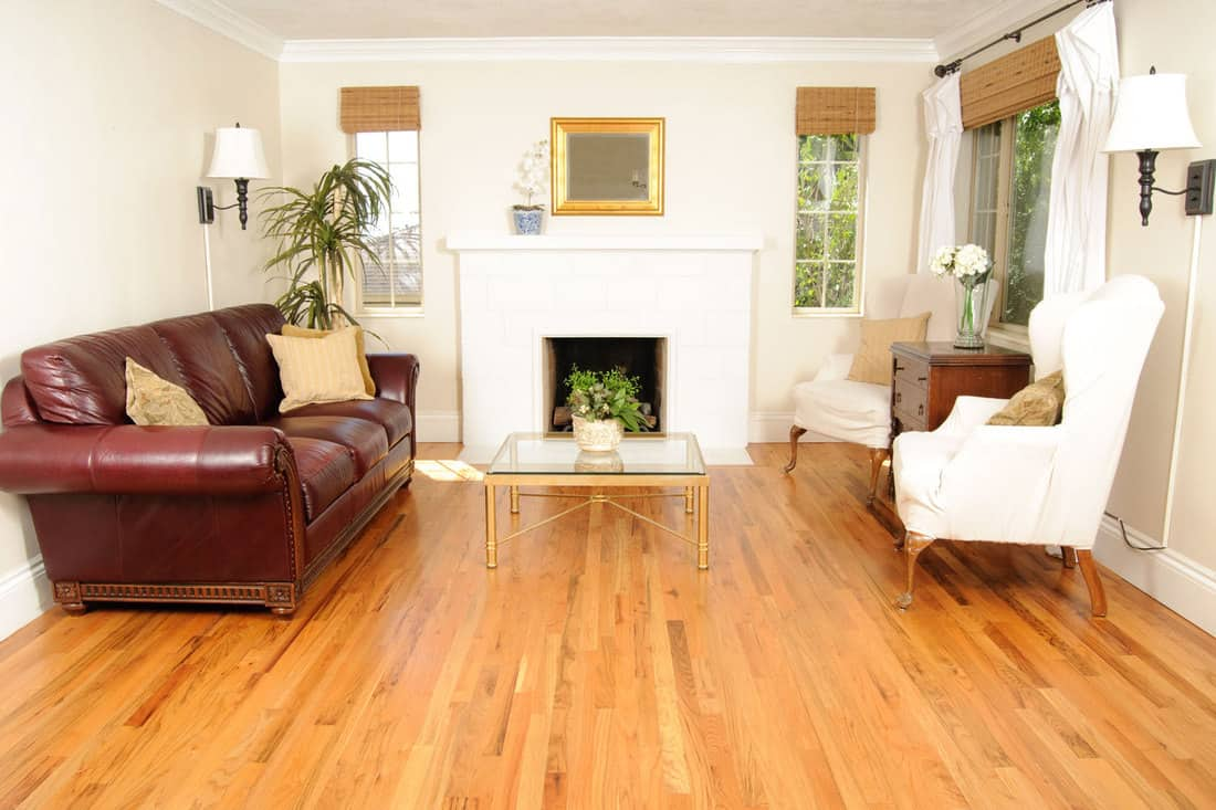 Living room with wingback chairs and hardwood floors