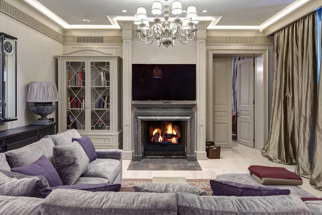 Luxurious living room with a large sofa and fireplace