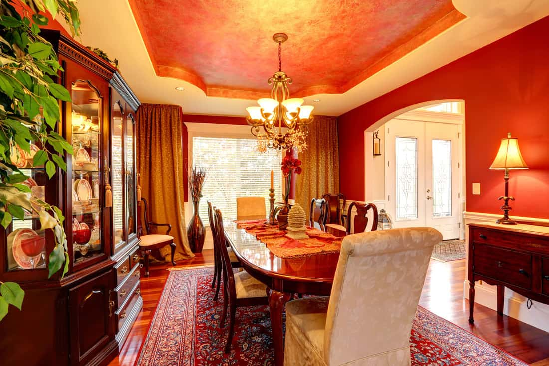 Luxury dining room in bright red colors