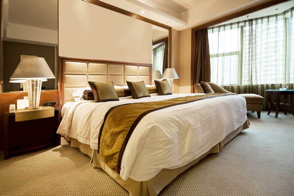 Luxury hotel bedroom with carpet flooring