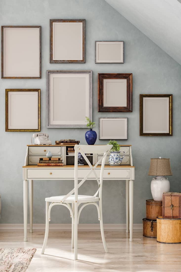 Mockup frames in vintage interior, personalized gallery wall with framed art and personal photographs