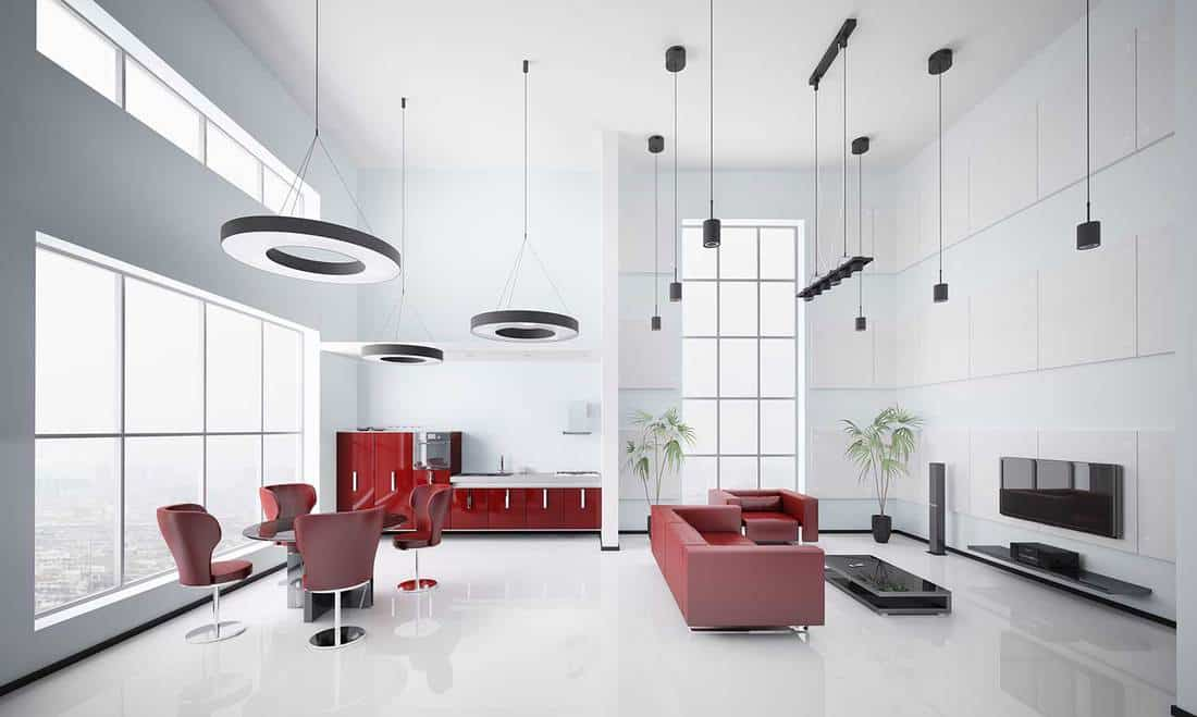 Modern apartment interior with white walls and red furnitures