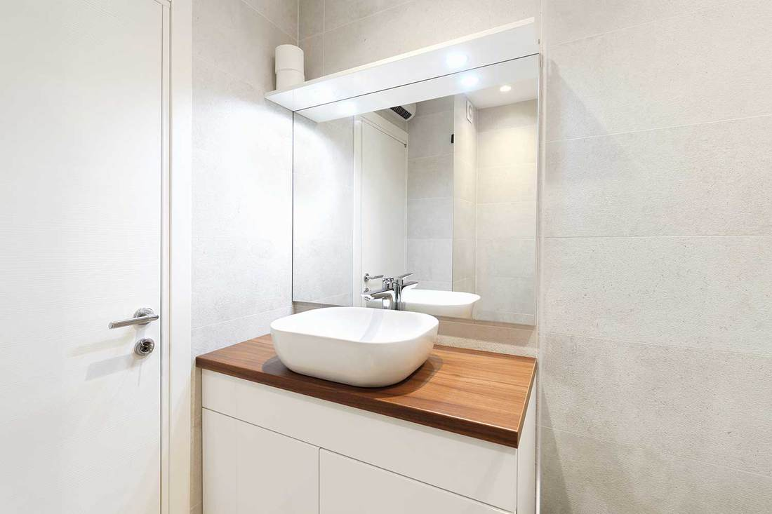 Modern bathroom interior with mirror and white sink