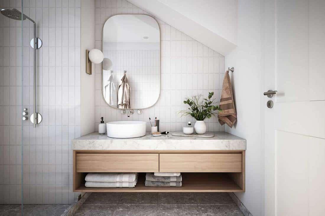 Modern bathroom interior with shower, mirror above sink