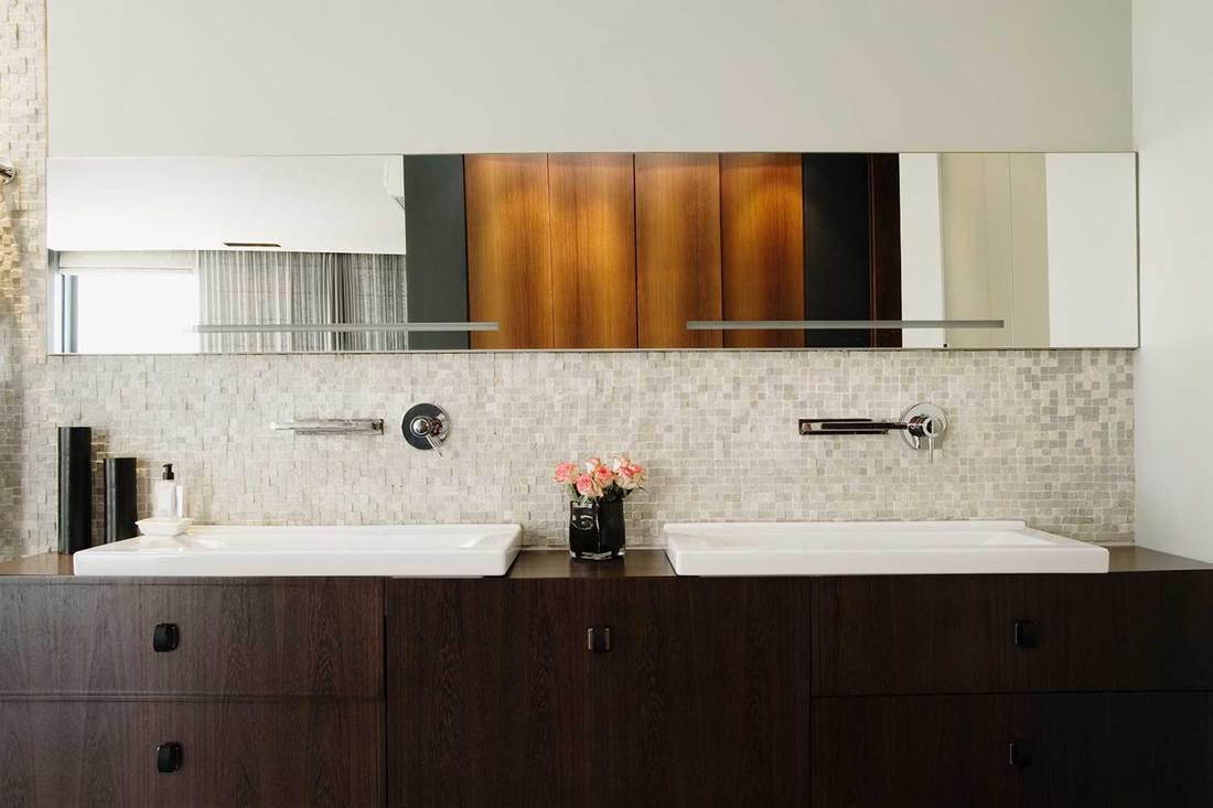 Modern bathroom vanity with dark brown cabinets