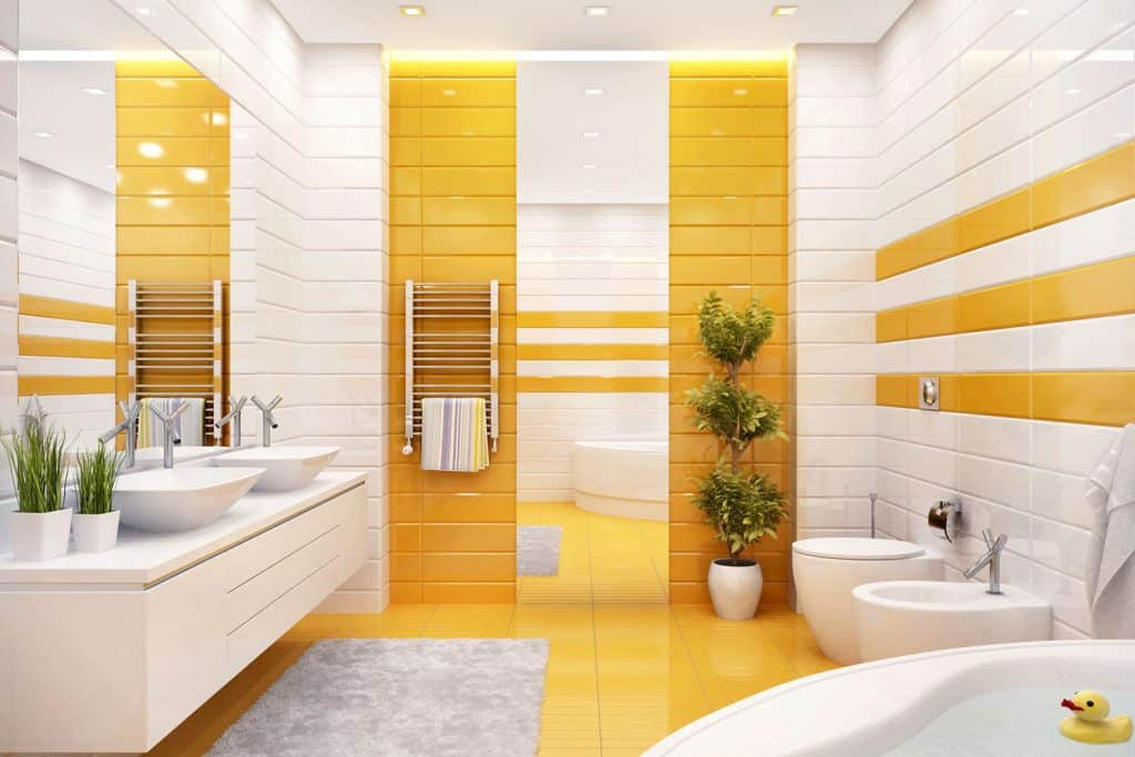 Modern contemporary bathroom with decorative orange tiles, orange flooring, and a white-vanity area with indoor plants