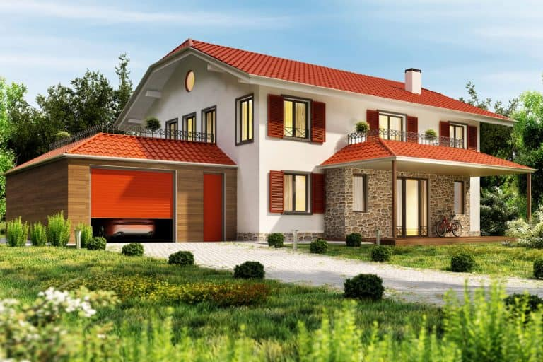 Modern country house with a red roof and a garage, What Color House Goes With A Red Roof?