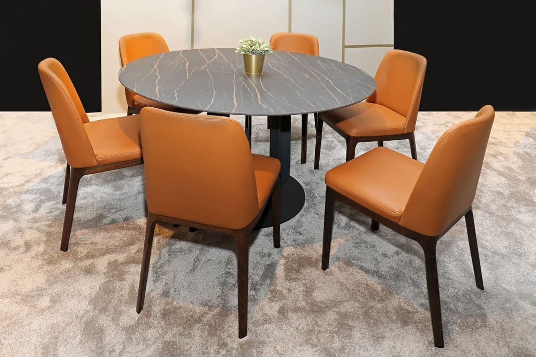 Modern dining room table interior with orange leather chairs furniture