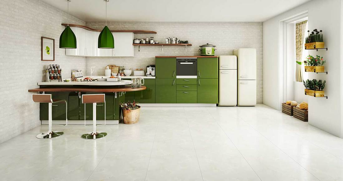 Modern green and white themed domestic kitchen interior design with tiled floor
