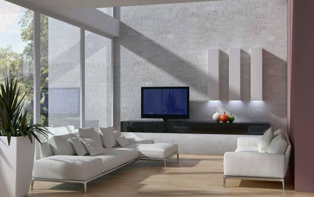 Modern interior living room with sofa set and brick walls
