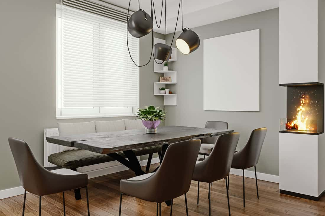 Modern italian design dining room with small fireplace and empty picture frame