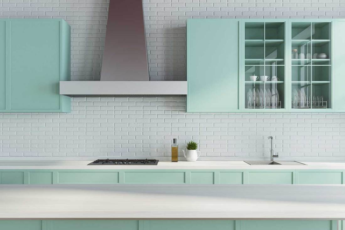 Modern kitchen with white brick walls, green countertops and kitchen cabinets