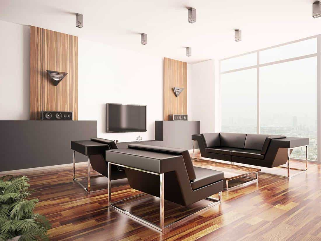 Modern living room interior with black sofa set and city view on large glass windows