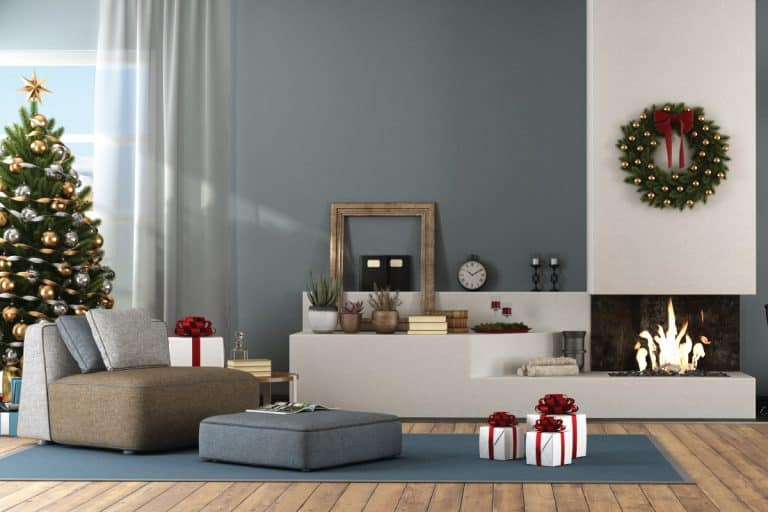 Modern living room with Christmas tree and fireplace. blue carpet and tan couch. What Color Couch Goes With Blue Carpet [7 Excellent Colors]