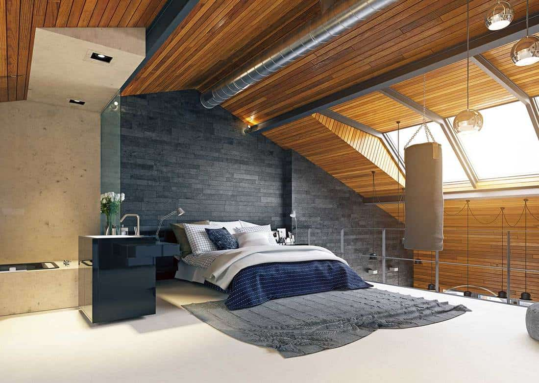 Modern loft bedroom interior with punching bag