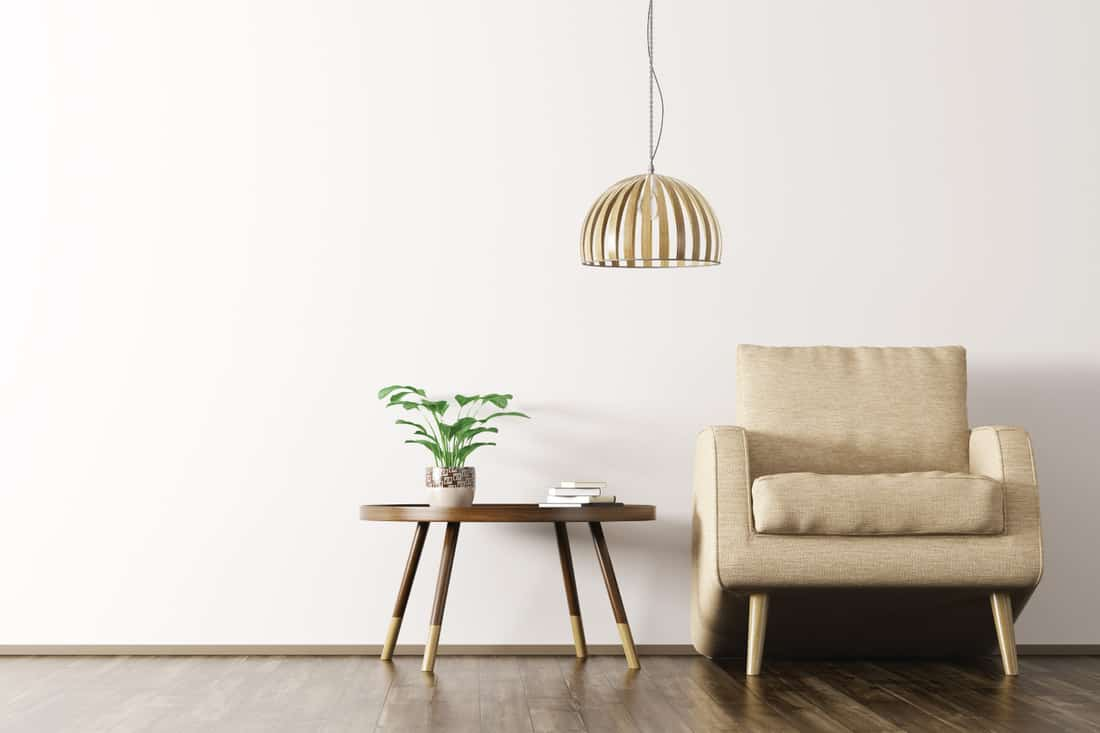 Modern Scandinavian living room interior with beige armchair, lamp and coffee table over white wall on the wooden floor, Tan Upholstered Chair With Wooden Legs