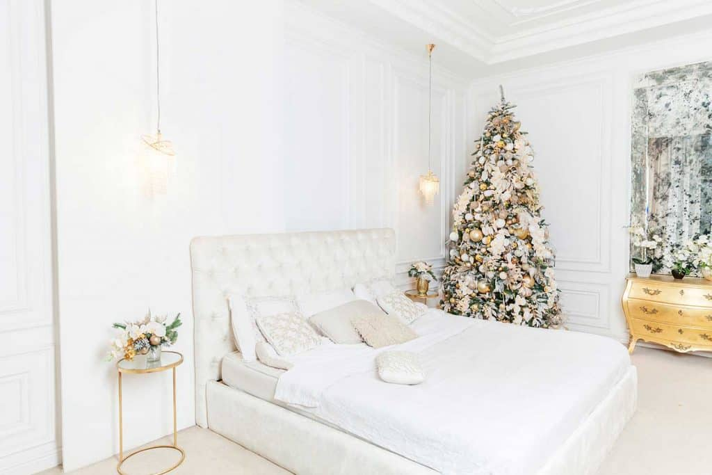 Modern white classical style interior design apartment bedroom with Christmas golden ornament decorations