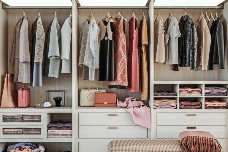 Modern wooden wardrobe with women clothes hanging on rail in walk in closet design interior, 15 Types Of Storage Furniture You Need To Know About