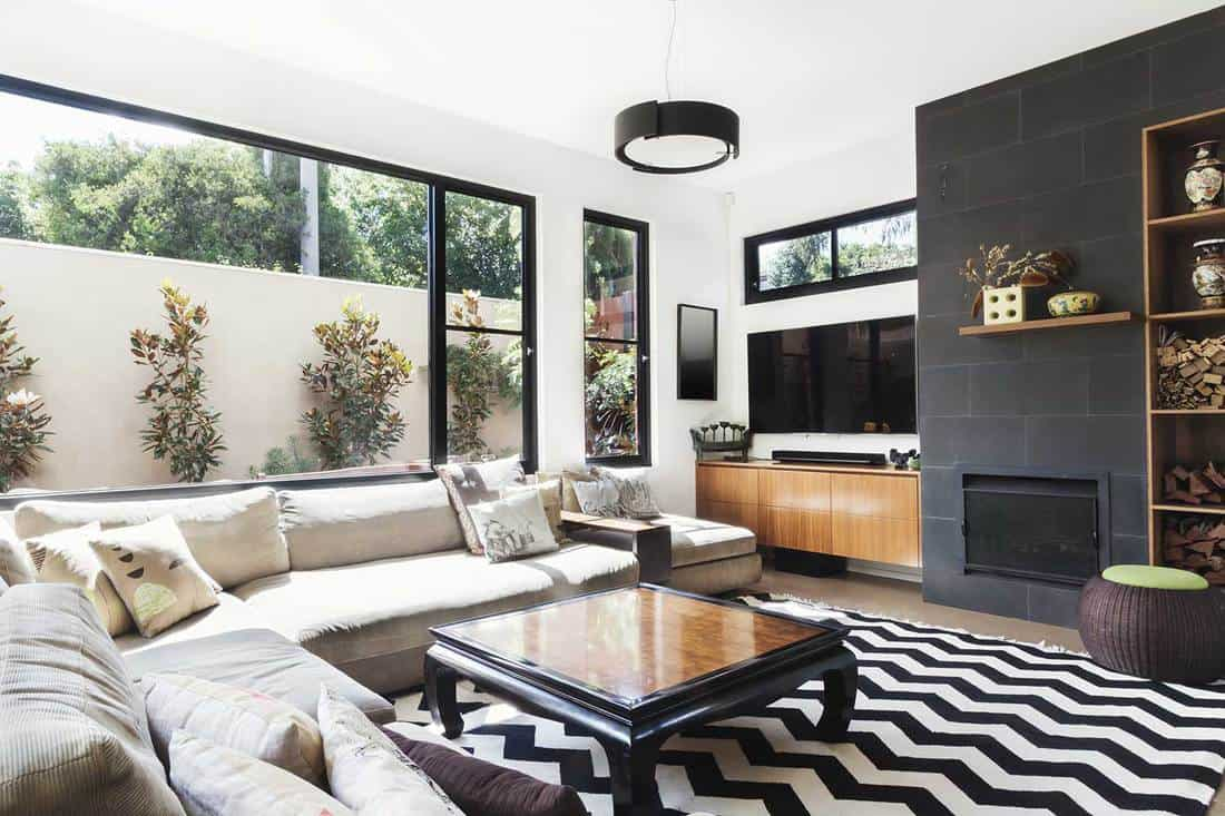 Monochrome living room with wood and gray tiling accents