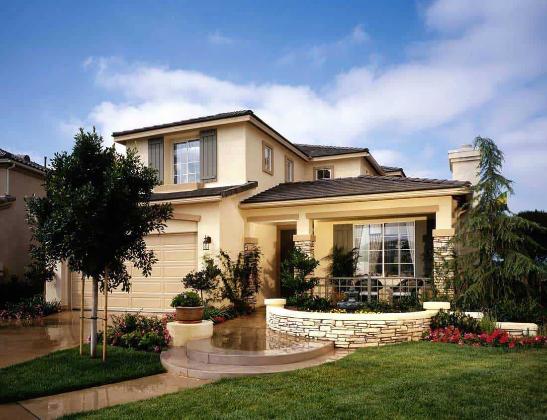 New home exterior with beige walls and tile roof