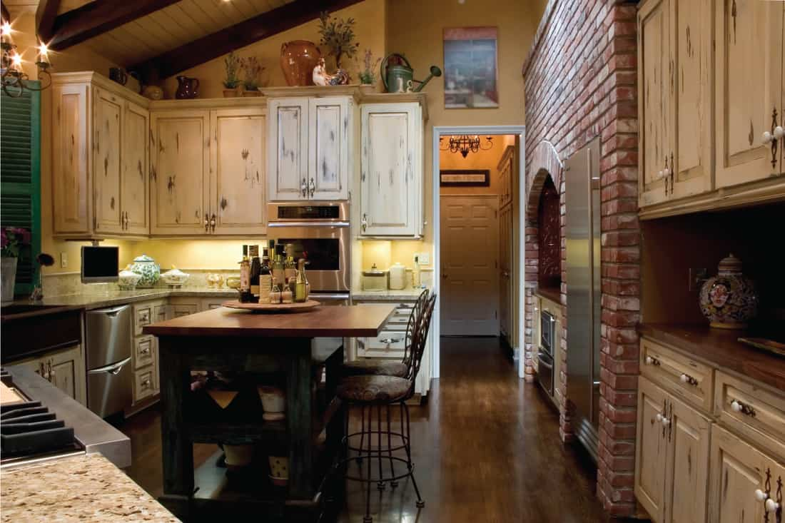 Newly remodeled Kitchen with a french farmhouse theme. Distressed white French country kitchen