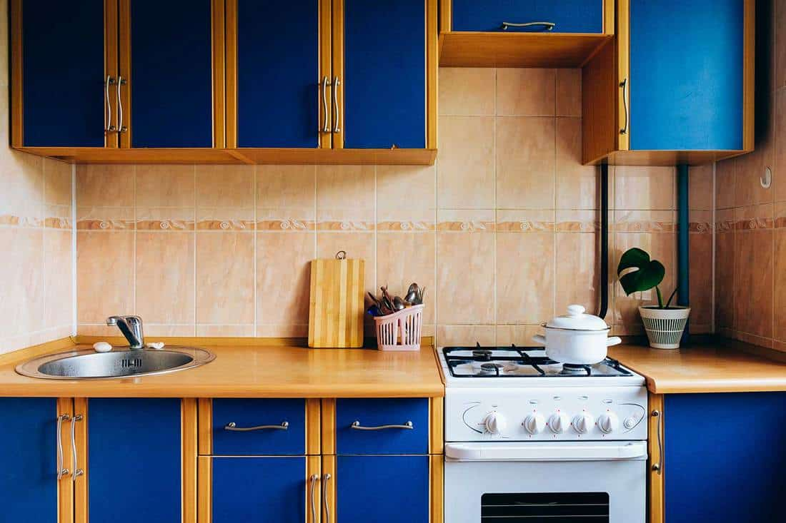 Old simple kitchen interior design with blue cabinets