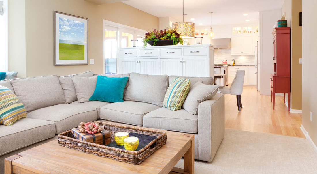 Open concept design model home interior featuring kitchen dinning room and family den.