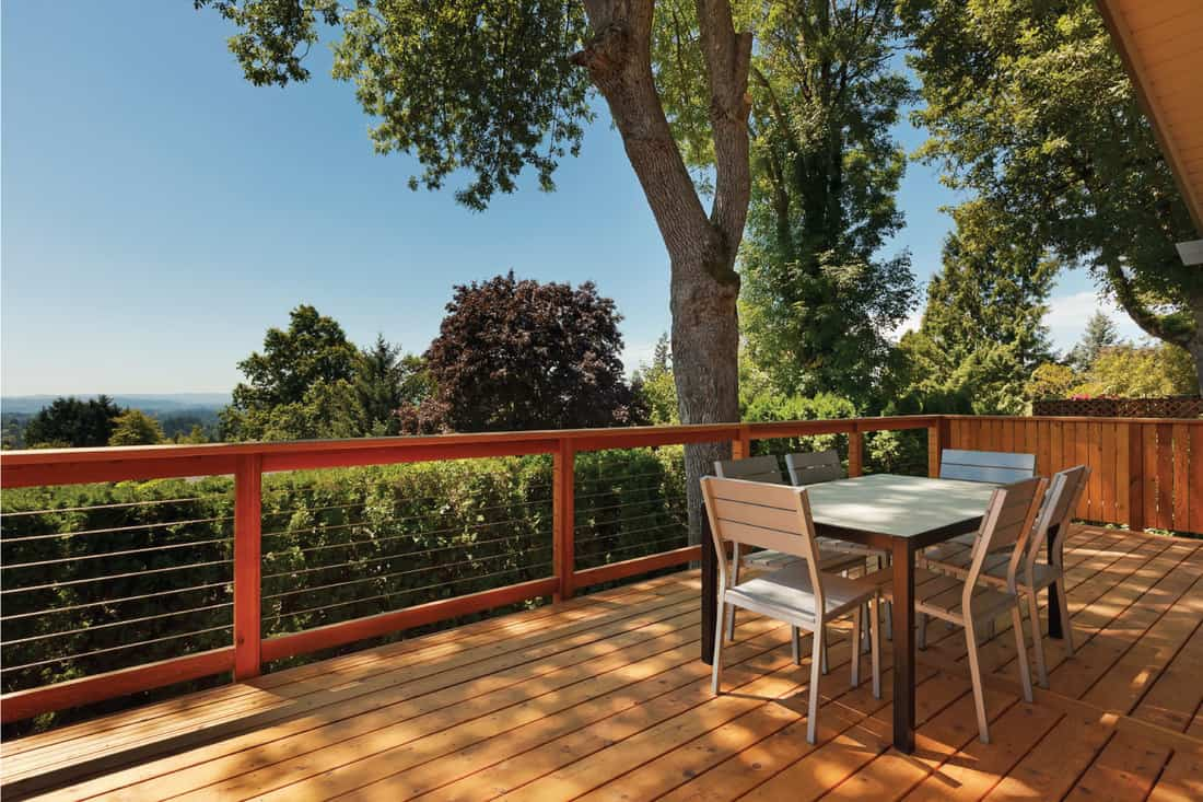 Outdoor dining area on beautiful deck with wire railing