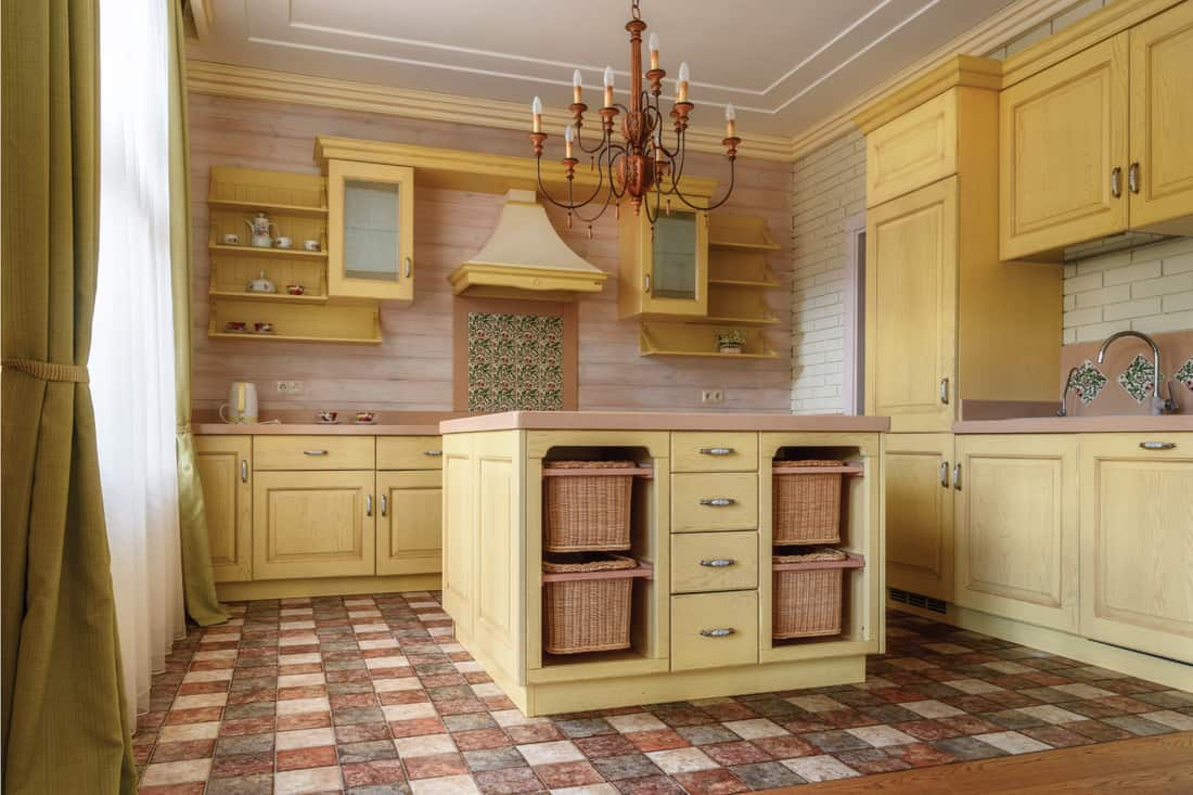 Pale yellow country kitchen. kitchen interior in modern country house